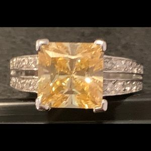 Yellow topaz with CZ accents.